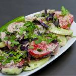 Salad with cucumbers and tomatoes cooked (with nuts and vinegar)