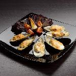 Stuffed mussels baked with a crispy crust of Parmesan cheese